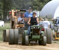Garden tractor pull - Isaac on his John Deere 112 powered with a 10 HP diesel engine